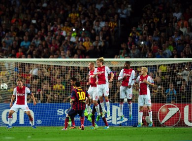 Barcelona's Lionel Messi scores the first goal from a free kick.
