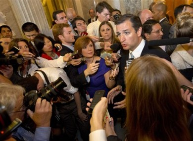 Ted Cruz speaks to the media after leaving a marathon speech on the Senate floor on Capitol Hill.