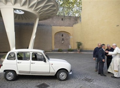 Pope Francis, right, speaks with Rev. Renzo Zocca, second from right, and owner of the Renault 4L seen at left, his assistant Luigi Macchioni, and car-body repairer Stefano Veronesi, fourth from right, after he was donated the car by Zocca.