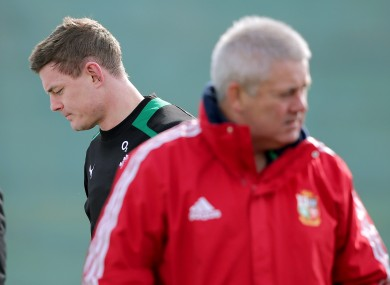 Brian O'Driscoll and Warren Gatland cross paths at an Ireland training session.
