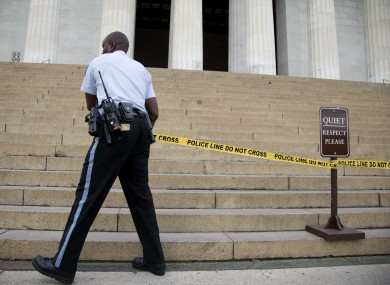 A US Park Police officer pulls police tape across the steps closing access to the Lincoln Memorial in Washington