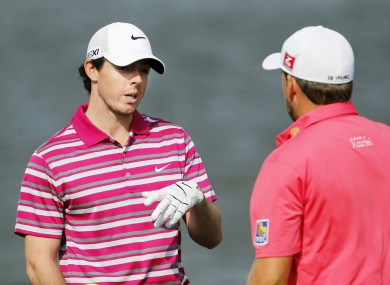 Rory McIlroy talks with his compatriot Graeme McDowell.