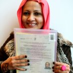 Dayseer Mohamed, from Sudan, now living in Clonsilla, displays her certificate of naturalisation of person of full age after a citizenship ceremony which took place in the Dublin Convention Centre, North Wall Quay, Dublin.<span class=