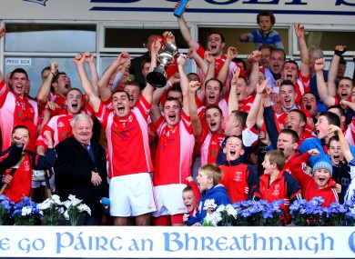 Passage joint captains Eoin Kelly and Conor Carey lift the cup.
