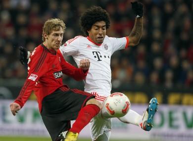 Leverkusen's Stefan Kiessling and and Bayern's Dante last season.