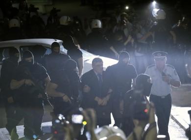 Nikos Michaloliakos, cente, escorted by anti-terror police as he a