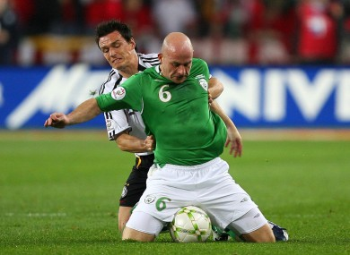 Lee Carsley tries a unique ball-shielding tactic against Piotr Trochowski of Germany in 2007.