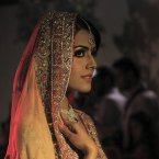 A Pakistani model presents a creation from the Saba Gul's bridal collection, in Peshawar, Pakistan. The fashion show was organized by the Fame Council to lift the mood of the city saddened by last weeks suicide attacks that killed scores of people and left many injured, according to Waqar Ahmed, an organiser of the event. <span class=