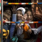 Pakistani children peek out of a bus as they leave school in Wajah Khiel, Swat Valley. One year after a Taliban bullet tried to silence Malala Yousufzai''s demand for education, she has published a book and is a contender for the Nobel Peace Prize. But still the militants threaten to kill her should she dare return home to Pakistan, and the principal at her old school says that as Malala's fame has grown, so has fear in her classrooms. <span class=