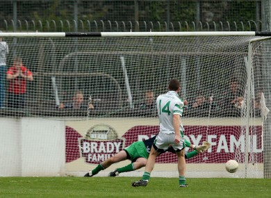 Sarsfields Patrick O'Sullivan saves a penalty from Ronan Sweeney of Moorefield.
