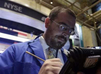 Trader Richard Scardino works on the floor of the New York Stock Exchange