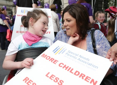 Lorraine Dempsey and her daughter Rianna (10) from Wicklow protest outside Leinster House last June.