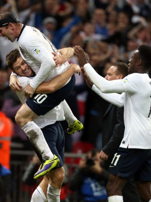 England's Steven Gerrard celebrates scoring his side's second goal with Wayne Rooney.