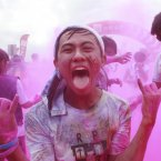Different color powder squirted to participants during the Color Run in Taipei, Taiwan<span class=