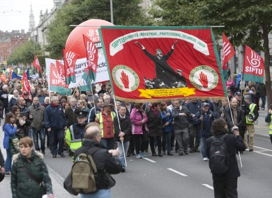 Trade union and community groups protest march