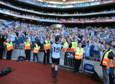 Dublin's Bernard Brogan lifts the Sam Maguire in front of supporters.