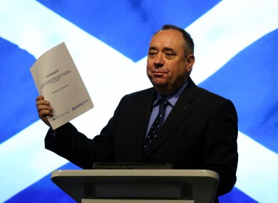 Alex Salmond holds a copy of the Scottish-UK agreement to hold a referendum, in this October 2012 photo