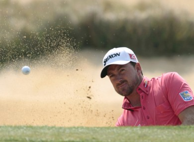 Graeme McDowell is four shots off the lead at the HSBC World Championships.