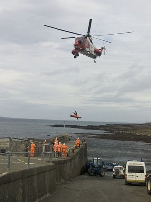 A Coastguard helicopter carries out an emergency evacuation in this 2006 file photo