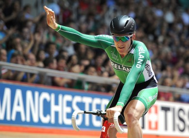 Ireland's Martyn Irvine celebrates winning gold in the Men's 30KM Points Race.