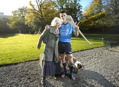 Dublin hurler Danny Sutcliffe meets a local lady walking her dogs.