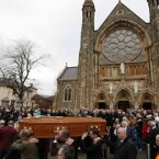The remains of Fr Alec Reid are carried from Clonard Monastery in West Belfast<span class=