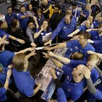 Best Buy employees rally after a pep talk as they prepare to open the store to shoppers on Black Friday in the USA. <span class=