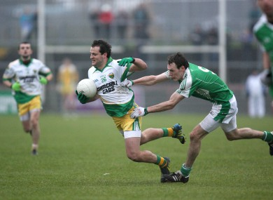Michael Murphy in action against James Sherry.