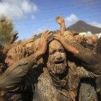 Iranian Shiites cover themselves with mud, during Ashoura, marking the death anniversary of Imam Hussein, the grandson of Islam's Prophet Muhammad, at the city of Bijar, west of the capital Tehran, Iran. Hussein, one of Shiite Islam's most beloved saints, was killed in a 7th century battle at Karbala, Iraq. <span class=