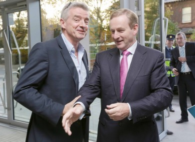 Who's hand is Enda reaching for?