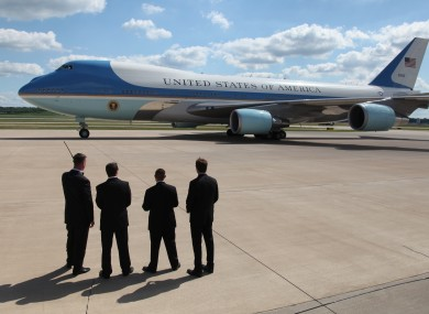 Secret Service agents watch as Barack Obama leaves on Air Force One (File photo)