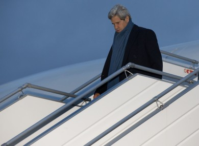 US Secretary of State John Kerry walks down the steps of his aircraft as he arrives at Geneva International airport