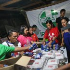 GOAL Volunteers pack food parcels for distribution.<span class=