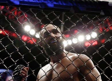 Johny Hendricks walks to his corner during a UFC 167 mixed martial arts championship against welterweight bout against Georges St. Pierre.