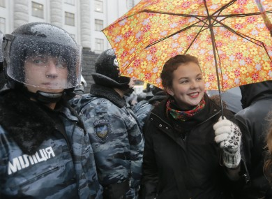 An opposition supporter smiles during protest in front of the Ukrainian Cabinet of Ministers in Kiev today.