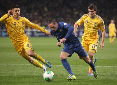 Franck Ribery with Evgeniy Haheridi, left, and Artem Fedetsky in the first leg.