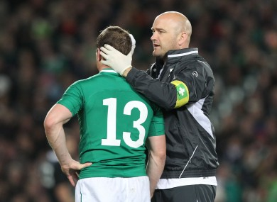 Dr Eanna Falvey treats Brian O'Driscoll for an injury in 2012.