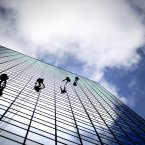 Window washers descend the 36-story Centennial Tower downtown skyscraper in Atlanta. <span class=