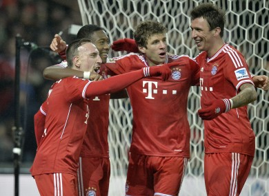 Ribery is congratulated by his team-mates.