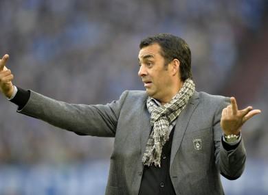 Bremen head coach Robin Dutt gesticulates during a German Bundesliga soccer match.