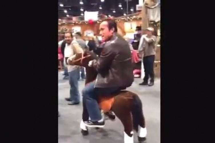 Arnold schwarzenegger the daily edge oh just arnold schwarzenegger riding around on a toy horse malvernweather Image collections