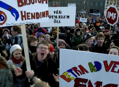 Around 2000 demonstrators crowd into a city square in Reykjavik, Iceland