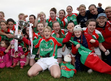 Carnacon's Marie Corbett celebrates with the trophy.