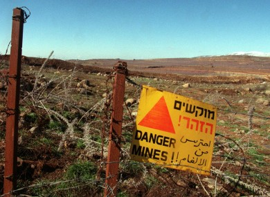 A sign warning of the danger of landmines in the Golan Heights.