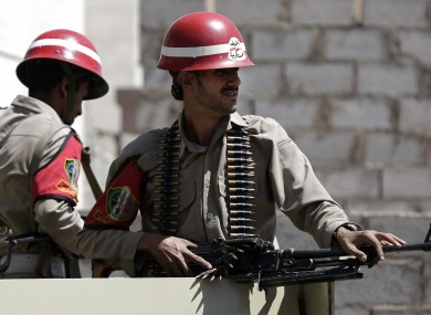 Yemeni military police stand guard outside a national security court.