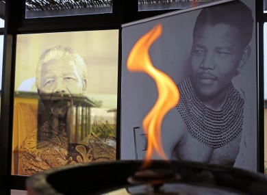 A flame burns in honour of Nelson Mandela at his childhood home of Qunu.