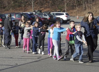 Connecticut State police lead children from the Sandy Hook Elementary School in Newtown, Connecticut, after the shooting