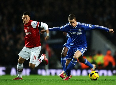 Mesut Ozil (left) and Fernando Torres.