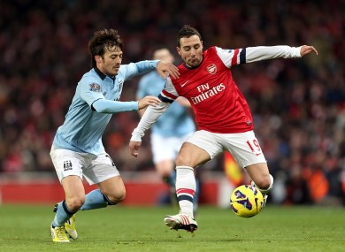 Arsenal's Santi Cazorla (right) and Manchester City's David Silva last season.