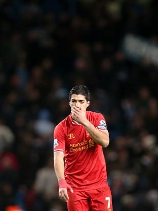 Liverpool's Luis Suarez shows his dejection after the final whistle against City.